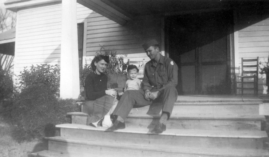 """In this image provided by the McConnell Center at the University of Louisville, Mitch McConnell sits with his parents, Julia """"Dean"""" and A.M. McConnell in this image from the mid 1940's in Five Points, Ala. As the coronavirus pandemic unfolds, Senate Majority Leader Mitch McConnell flashes back to an earlier crisis that gripped the nation, and his own life, when he was a boy. He was struck with polio. (McConnell Center at the University of Louisville via AP)"""
