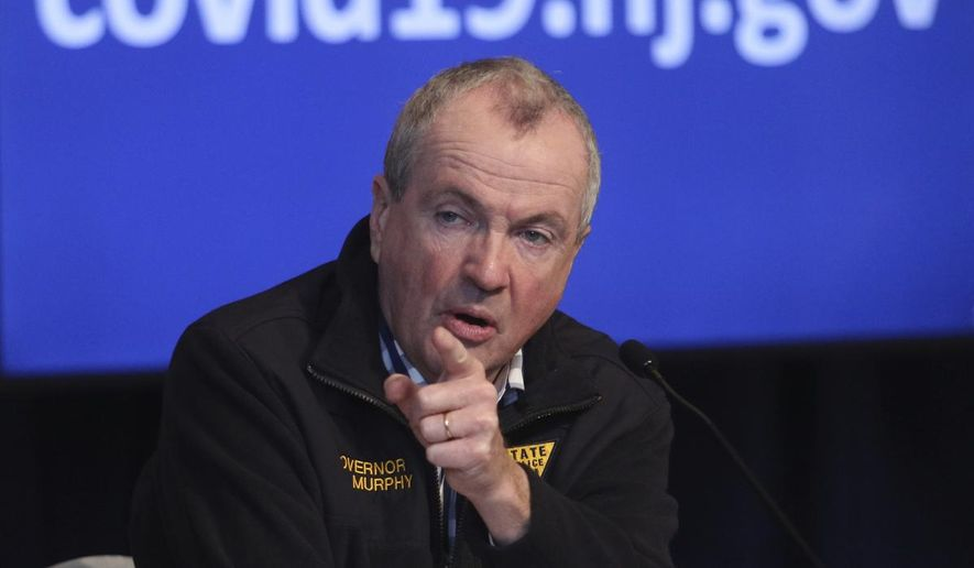 New Jersey Gov. Phil Murphy speaks during his daily press briefing about the new coronavirus, Friday, April 10, 2020, at the War Memorial in Trenton, N.J. (Chris Pedota/The Record via AP)