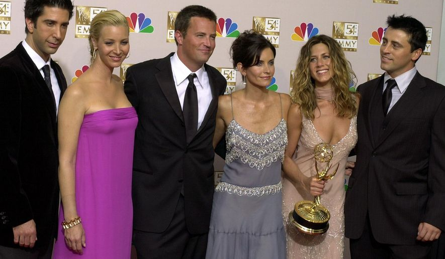 """FILE - In this Sept. 22, 2002, file photo, the cast of """"Friends,"""" from left, David Schwimmer, Lisa Kudrow, Matthew Perry, Courteney Cox, Jennifer Aniston and Matt LeBlanc pose in the press room with the award for outstanding comedy series at the 54th annual Primetime Emmy Awards in Los Angeles. The """"Friends"""" reunion won't be here for us as soon as expected. Production on the special has been delayed by the coronavirus pandemic that's brought movie and TV making to a standstill. The special with the original """"Friends"""" cast was to be part of the May launch of the new HBO Max streaming service. The company said Friday that no taping was done before the crisis hit. (AP Photo/Reed Saxon, File)"""