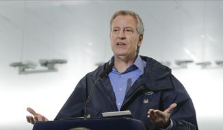 New York City Mayor Bill de Blasio speaks at the USTA Indoor Training Center where a 350-bed temporary hospital will be built in New York, March 31, 2020. (AP Photo/Frank Franklin II, File) ** FILE **
