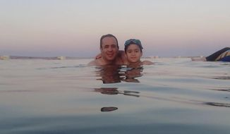This 2016 photo provided by Israa el-Lawah shows Dr. Ahmed el-Lawah and his son during a vacation in Egypt. El-Lawah died on Monday, March 30, 2020, after he was infected by the new coronavirus. He was the first doctor to die from the COVID-19, the disease caused by the virus in Egypt. (Israa el-Lawah via AP)