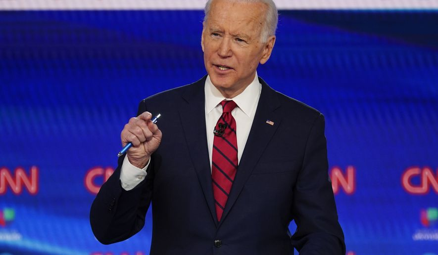 In this March 15, 2020, photo, Sen. Bernie Sanders, I-Vt., and former Vice President Joe Biden, participate in a Democratic presidential primary debate at CNN Studios in Washington. A former aide to Biden is accusing the presumptive Democratic presidential nominee of sexually assaulting her during the early 1990s when he was a senator. Biden's campaign denies the charges. (AP Photo/Evan Vucci)
