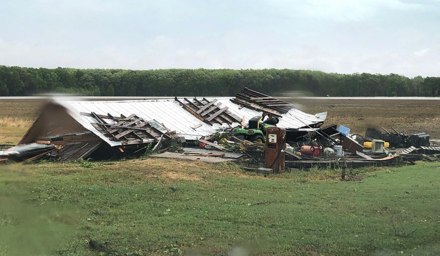 In this image made from video provided by WLBT-TV strong storms pound parts of the Deep South, including this house and shed in Yazoo County, Miss., Sunday, April 12, 2020. Winds damaged buildings and toppled trees throughout Louisiana and Mississippi as they advance to Tennessee and Alabama. (Mike Evans/WLBT-TV, via AP)