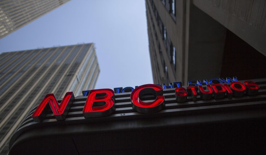 "This May 10, 2017, file photo shows an NBC logo at their television studios at Rockefeller Center in New York. For the first time in its lengthy history, ""Saturday Night Live"" on April 11, 2020, held an all-quarantine version, with stars delivering taped material primarily from their homes. (AP Photo/Mary Altaffer, File)"