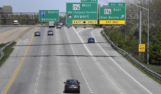 Cars travel along Interstate 97 in Glen Burnie, Md., Monday, April 6, 2020. America's roads are a lot less congested, due to coronavirus shutdowns that have kept millions of commuters, shoppers and vacationers parked at their homes. While that makes it easier to patch potholes, it also could spell trouble for road and bridge projects, as revenue from tolls, fuel taxes and other user fees declines. (AP Photo/Susan Walsh)