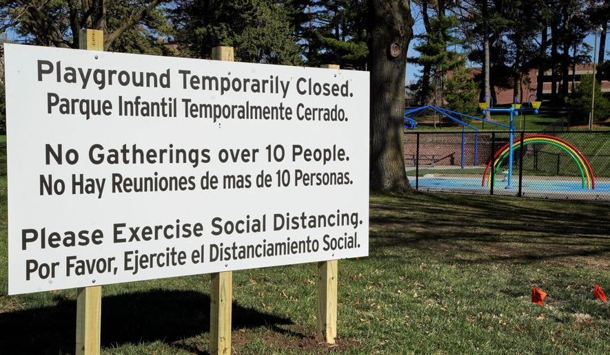 A sign announces the closing of a Omaha, Nebraska, playground. Nebraska is one of eight states without stay-at-home orders.