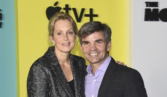 "In this Oct. 28, 2019, file photo Ali Wentworth, left, and her husband George Stephanopoulos attend the world premiere of Apple TV+'s ""The Morning Show"" in New York. Stephanopoulos says he has tested positive for the coronavirus, but is relatively symptom-free. (Photo by Evan Agostini/Invision/AP, File)"