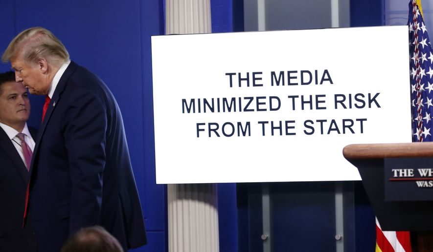 President Donald Trump walks from the podium as a White House produced video plays during a briefing about the coronavirus in the James Brady Press Briefing Room at the White House, Monday, April 13, 2020, in Washington. (AP Photo/Alex Brandon)