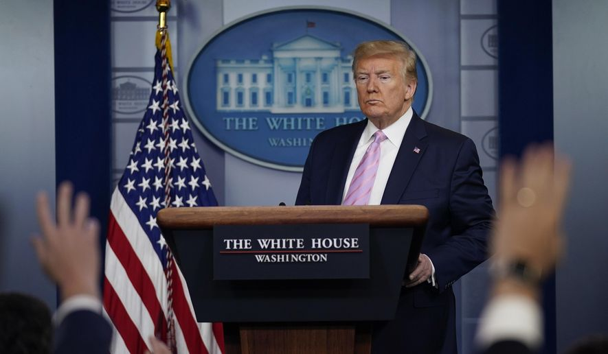 In this Friday, April 10, 2020, photo, President Donald Trump answers questions during a coronavirus task force briefing at the White House in Washington. (AP Photo/Evan Vucci) **FILE**