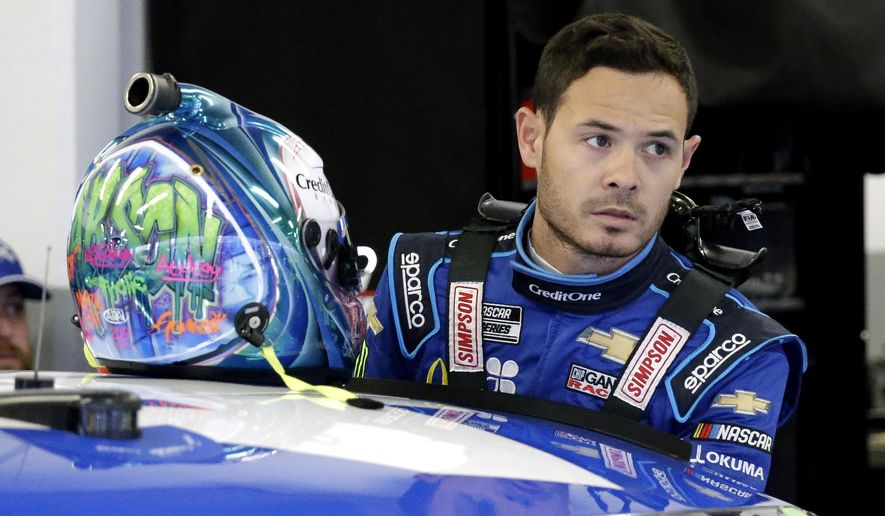 In this Feb. 14, 2020, file photo, Kyle Larson gets ready to climb into his car to practice for the NASCAR Daytona 500 auto race at Daytona International Speedway in Daytona Beach, Fla. Kyle Larson used a racial slur on a live stream Sunday. April 12, 2020, during a virtual race — the second driver in a week to draw scrutiny while using the online racing platform to fill time during the coronavirus pandemic.(AP Photo/Terry Renna, File)  **FILE**