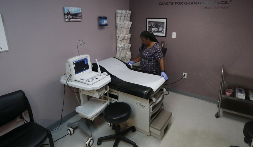 In this Sept. 4, 2019 file photo, Director of Clinical Services Marva Sadler, prepares the operating room at the Whole Woman's Health clinic in Fort Worth, Texas. On April 22, 2020, a federal court allowed Arkansas to ban most surgical abortions during the coronavirus pandemic.(AP Photo/Tony Gutierrez) **FILE**