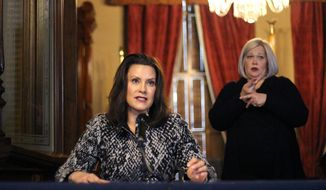 """In this image provided by the Michigan Office of the Governor, Michigan Gov. Gretchen Whitmer addresses the state during a speech in Lansing, Mich., Monday, April 13, 2020. The governor said the state has tough days ahead in its fight against the coronavirus pandemic, but a return to normalcy is """"on the horizon."""" (Michigan Office of the Governor via AP, Pool)"""