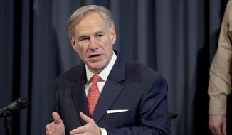 Texas Gov. Greg Abbott speaks about the state's response to COVID-19 during a news conference on Monday, April 13, 2020, in Austin, Texas. (Nick Wagner/Austin American-Statesman via AP) **FILE**