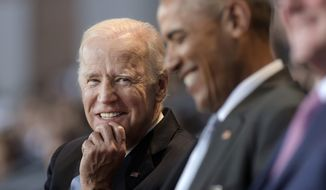 In this Jan. 4, 2017, file photo, Vice President Joe Biden, left, watches President Barack Obama, center, at Conmy Hall, Joint Base Myer-Henderson Hall, Va. (AP Photo/Susan Walsh) ** FILE **