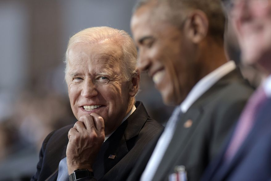 In this Jan. 4, 2017, file photo, then-Vice President Joe Biden, left, watches President Barack Obama, center, at Conmy Hall, Joint Base Myer-Henderson Hall, Va. (AP Photo/Susan Walsh) ** FILE **