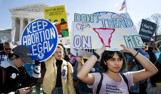 In this Wednesday, March 4, 2020, file photo, abortion rights demonstrators rally outside the Supreme Court in Washington. (AP Photo/Jacquelyn Martin File) ** FILE **