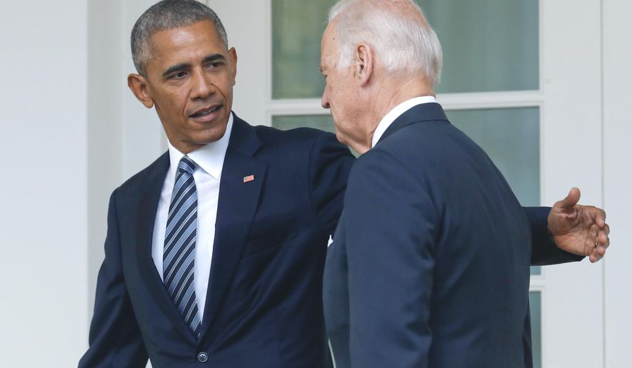 FILE - In this Nov. 9, 2016 file photo, President Barack Obama, accompanied by Vice President Joe Biden, walks back to the Oval Office in Washington, after speaking about the election in the Rose Garden. (AP Photo/Pablo Martinez Monsivais)
