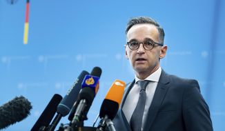 German Foreign Minister Heiko Maas briefs the media during a news conference on current developments in the worldwide spread of the coronavirus at the foreign ministry in Berlin, Germany, Tuesday, March 17, 2020. For most people, the new coronavirus causes only mild or moderate symptoms, such as fever and cough. For some, especially older adults and people with existing health problems, it can cause more severe illness, including pneumonia. (Bernd von Jutrczenka/dpa via AP)