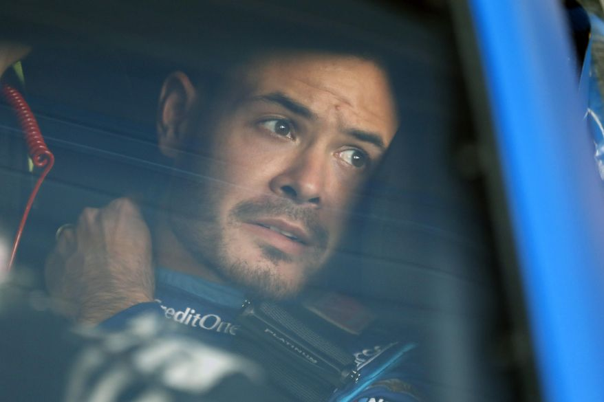 In this Oct. 18, 2019, file photo, Kyle Larson sits in his car before the final practice for a NASCAR Cup Series auto race at Kansas Speedway in Kansas City, Kan. Kyle Larson was fired Tuesday, April 14, 2020, by Chip Ganassi Racing, a day after nearly every one of his sponsors dropped the star driver for using a racial slur during a live stream of a virtual race. Larson, in his seventh Cup season with Ganassi and considered the top free agent in NASCAR mere weeks ago, is now stunningly out of a job in what could ultimately be an eight-figure blunder by the star.  (AP Photo/Colin E. Braley, File)  **FILE**
