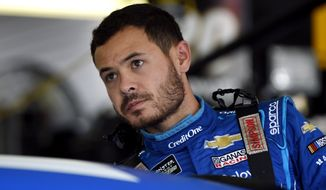 In this July 27, 2019, file photo, Kyle Larson climbs into his car for a practice session for the NASCAR Cup Series auto race in Long Pond, Pa. Kyle Larson was fired Tuesday, April 14, 2020, by Chip Ganassi Racing, a day after nearly every one of his sponsors dropped the star driver for using a racial slur during a live stream of a virtual race. Larson, in his seventh Cup season with Ganassi and considered the top free agent in NASCAR mere weeks ago, is now stunningly out of a job in what could ultimately be an eight-figure blunder by the star.  (AP Photo/Derik Hamilton, File)