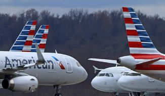 In this Tuesday, March 31, 2020, file photo, these are some of the 88 American Airlines planes stored at Pittsburgh International Airport in Imperial, Pa. (AP Photo/Gene J. Puskar, File)