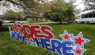 FILE-This Wednesday April 8, 2020 file photo shows a sign stating the 'Heroes Work Here' has been placed in the grounds of the Canterbury Rehabilitation & Healthcare Center in Richmond, Va. (AP Photo/Steve Helber,File)