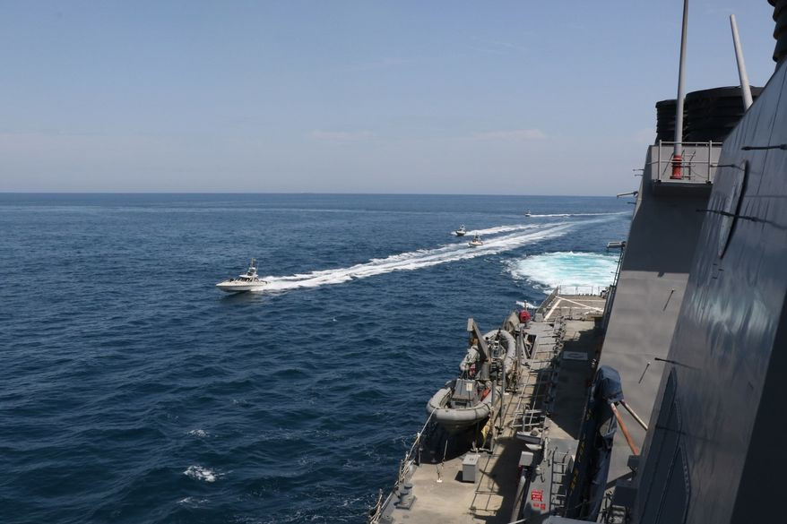 NORTH ARABIAN GULF (April 15, 2020) Iranian Islamic Revolutionary Guard Corps Navy (IRGCN) vessels conducted unsafe and unprofessional actions against U.S. Military ships by crossing the ships' bows and sterns at close range while operating in international waters of the North Arabian Gulf. The guided-missile destroyer USS Paul Hamilton (DDG 60) is conducting joint interoperability operations in support of maritime security in the U.S. 5th Fleet area of operations. (U.S. Navy photo) ** FILE **