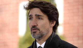 Canadian Prime Minister Justin Trudeau speaks during his daily press conference on the COVID-19 pandemic outside of his residence at Rideau Cottage in Ottawa, Ontario, on Friday, April 10, 2020. (Justin Tang/The Canadian Press via AP) ** FILE **