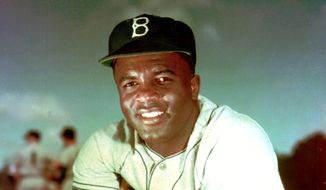 In this 1952 file photo, Brooklyn Dodgers baseball player Jackie Robinson poses. Forced from the field by the new coronavirus, Major League Baseball is moving its annual celebration of Jackie Robinson online. The Jackie Robinson Foundation is launching a virtual learning hub to coincide with the 73rd anniversary Wednesday, April 15, 2020, of Robinson breaking the major league color barrier. (AP Photo/File)  **FILE**