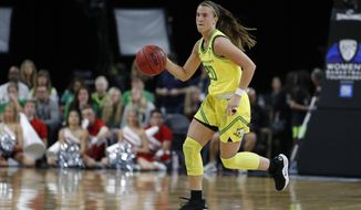 FILE - In this March 6, 2020, file photo, Oregon's Sabrina Ionescu (20) plays against Utah in an NCAA college basketball game in the quarterfinal round of the Pac-12 women's tournament in Las Vegas. The Associated Press had a panel of WNBA coaches and general managers hold a mock draft. (AP Photo/John Locher) ** FILE **