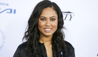 In this Oct. 8, 2015 file photo, Ayesha Curry arrives at the Autism Speaks to LA Celebrity Chef Gala in Santa Monica, Calif. A celebrity branding company is seeking at least $10 million in a breach-of-contract lawsuit against Curry, food and lifestyle personality and wife of NBA star Stephen Curry. (Photo by Rich Fury/Invision/AP, File)