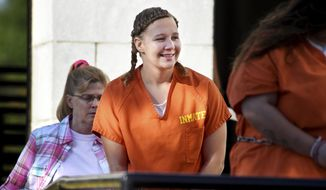In this June 26, 2018, file photo, Reality Winner walks into the Federal Courthouse in Augusta, Ga. (Michael Holahan/The Augusta Chronicle via AP, File)