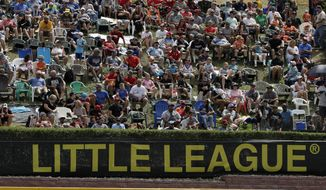 In this Aug. 24, 2019, photo, Little League fans watch from the hillside overlooking left field at Lamade Stadium during the International Championship baseball game between Curacao and Japan at the Little League World Series tournament in South Williamsport, Pa.  (AP Photo/Gene J. Puskar)  **FILE**