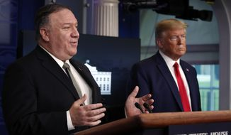 President Donald Trump listens as Secretary of State Mike Pompeo speaks about the coronavirus in the James Brady Press Briefing Room of the White House, Wednesday, April 8, 2020, in Washington. (AP Photo/Alex Brandon) ** FILE **