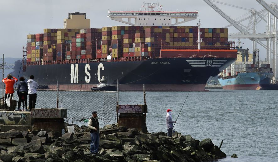MSC Anna, the largest active cargo ship in North America, is aided by tugboats as she prepares to dock at the Port of Oakland on Thursday, April 16, 2020, in Oakland, Calif. MSC Anna, which is 1,312 feet long, is transporting a backlog of empty containers and will be unloading imports. (AP Photo/Ben Margot)