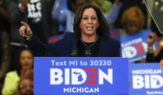 In this March 9, 2020, file photo Sen. Kamala Harris, D-Calif., speaks at a campaign rally for presumptive Democratic presidential candidate former Vice President Joe Biden at Renaissance High School in Detroit. Harris is raising money for Biden while speaking out about the disproportionate number of African Americans with COVID-19. (AP Photo/Paul Sancya, File)
