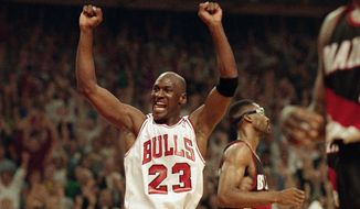 In this June 14, 1992, file photo, Michael Jordan celebrates the Bulls win over the Portland Trail Blazers in the NBA Finals in Chicago. Decades after Jordan's groundbreaking departure from college, March Madness and the NBA's mega-millions have taken all the novelty out of leaving early for the pros. (AP Photo/John Swart) ** FILE **