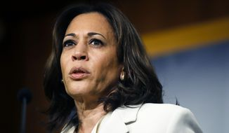 FILE - In this Jan. 16, 2020 file photo, Sen. Kamala Harris, D-Calif., talks to reporters about the impeachment trial of President Donald Trump on charges of abuse of power and obstruction of Congress, at the Capitol in Washington.  As presumptive Democratic presidential nominee Joe Biden begins the process of choosing a running mate amid the coronavirus crisis, managing the pandemic has become its own version of an audition. For potential picks, lobbying for the job means breaking into the national conversation, positioning themselves as leaders and executing at their day job.  (AP Photo/Matt Rourke)