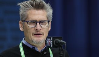 FILE - In this Feb. 25, 2020, file photo, Atlanta Falcons general manager Thomas Dimitroff speaks during a press conference at the NFL football scouting combine in Indianapolis. Dimitroff will be operating his 13th NFL draft as the Atlanta Falcons' general manager from the solitude of his home, following the mandate placed on each team by commissioner Roger Goodell. Dimitroff has made a trade in each of his 12 previous drafts. Don't bet against the trade-happy GM extending that streak this year. (AP Photo/Michael Conroy, File)