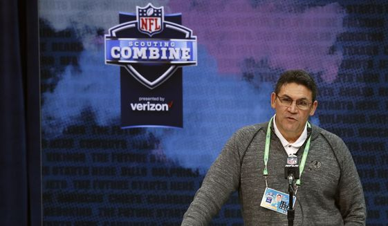 In this Feb. 26, 2020, file photo, Washington Redskins head coach Ron Rivera speaks during a press conference at the NFL football scouting combine in Indianapolis. This is supposed to be the Redskins' Chase Young draft. The chance to select the Ohio State pass-rusher with the second overall pick is a possible silver lining of a 3-13 season. Young is considered the top defensive player available after putting up 46 tackles and 16 1/2 sacks last year. New Redskins coach Ron Rivera cautioned to wait to see what happens with the No. 1 pick first. He has also taken calls from other teams about trading down. (AP Photo/Charlie Neibergall, File)  **FILE**