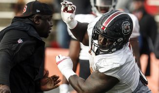 South Carolina's Javon Kinlaw of the South squad runs drills during practice for the Senior Bowl Wednesday, Jan. 22, 2020, in Mobile, Ala. (AP Photo/Butch Dill)