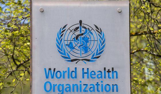 The logo and building of the World Health Organization (WHO) headquarters in Geneva, Switzerland, 15 April 2020.  (Martial Trezzini/Keystone via AP)  **FILE**