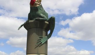A statue of a frog is adorned with a face mask is perched upon a pedestal on a bridge spanning the Willimantic River, Thursday, April 16, 2020 in Willimantic, Conn. Connecticut Gov. Ned Lamont has advised people to wear masks in public due to the COVID-19 pandemic. (AP Photo/Pat Eaton-Robb)
