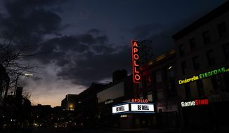 """The Apollo Theater is closed due to the coronavirus pandemic but carries the message """"Be Well,"""" Thursday, April 16, 2020, in the Harlem neighborhood of New York. Many entertainment venues are closed nationwide during the pandemic. (AP Photo/Mark Lennihan)"""
