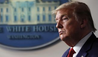 President Donald Trump listens as Dr. Deborah Birx, White House coronavirus response coordinator,speaks about the coronavirus in the James Brady Press Briefing Room of the White House, Thursday, April 16, 2020, in Washington. (AP Photo/Alex Brandon)