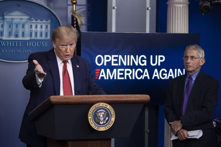 President Donald Trump speaks about the coronavirus, accompanied by Dr. Anthony Fauci, director of the National Institute of Allergy and Infectious Diseases, in the James Brady Press Briefing Room of the White House, Thursday, April 16, 2020, in Washington. (AP Photo/Alex Brandon)