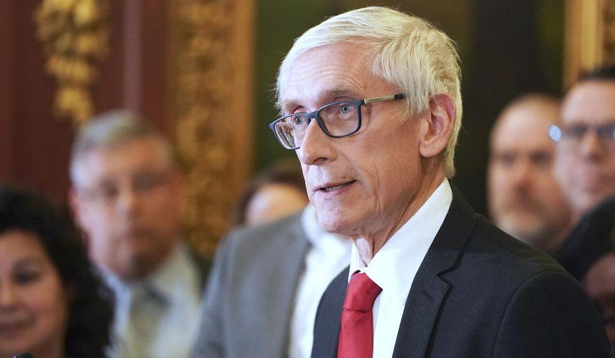 In this Feb. 6, 2020 file photo, Wisconsin Gov. Tony Evers holds a news conference in Madison, Wis. Wisconsin's tenuous bipartisan detente in fighting the coronavirus pandemic broke down this week with Gov. Evers' decision to extend a stay-at-home order through Memorial Day, a divide likely to result in lawsuits that may determine who has the power to say when the state can start to reopen. (Steve Apps/Wisconsin State Journal via AP, File)