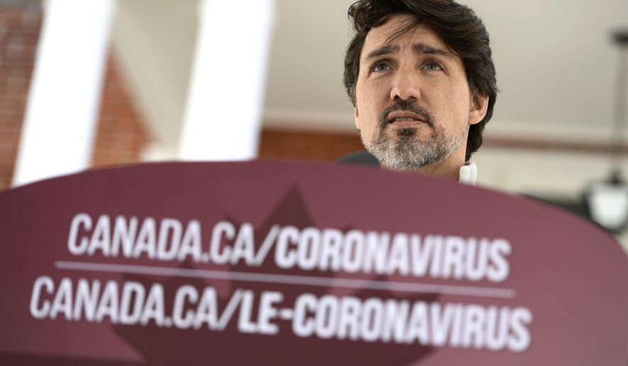 Canadian Prime Minister Justin Trudeau speaks during his daily press conference on the COVID-19 pandemic, in front of his residence at Rideau Cottage, in Ottawa, Ontario, on Saturday, April 18, 2020. (Justin Tang/The Canadian Press via AP)