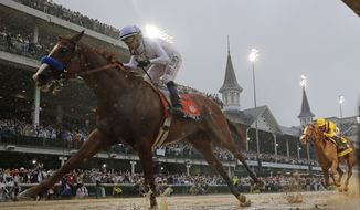In this May 5, 2018, file photo, Mike Smith rides Justify to victory during the 144th running of the Kentucky Derby horse race at Churchill Downs in Louisville, Ky. The move of the Triple Crown's first leg to Labor Day weekend due to the coronavirus pandemic will mark the first time the Derby won't run on the first Saturday in May since 1945. (AP Photo/Morry Gash, File)  **FILE**