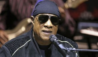 """FILE - In this Nov. 27, 2018, file photo, Stevie Wonder performs live at a news press conference for the """"House Full of Toys 22nd annual Benefit Concert"""" in Los Angeles. Through music, Lady Gaga told those stressing during the coronavirus pandemic to smile and Stevie Wonder encouraged viewers to lean on one another. The A-listers kicked off the two-hour TV special """"One World: Together At Home"""" Saturday, April 18, 2020. (Photo by Willy Sanjuan/Invision/AP, File)"""